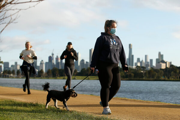 People exercising at Albert Park Lake in Melbourne on Tuesday.