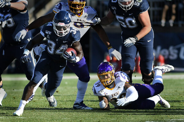 Connecticut running back Kevin Mensah during a game in November against East Carolina. UConn said on Wednesday that it would cancel the 2020 football season because of the coronavirus pandemic.