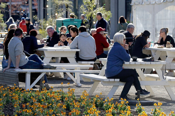 People enjoying lunch in Christchurch, New Zealand, on Sunday.