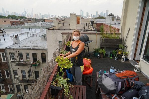 Elena Gaudino on her terrace in Brooklyn, with the camping gear she'll use on her vacation.