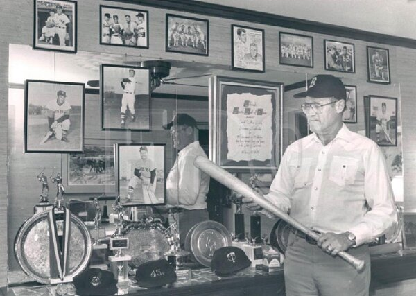Carroll Hardy with his baseball memorabilia in 1986. He played eight seasons in the major leagues but is remembered mostly for one at-bat.