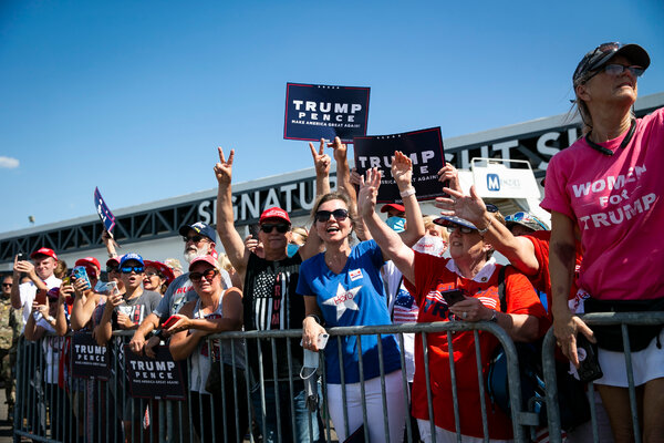Supporters of President Trump on the tarmac of Tampa International Airport in July.