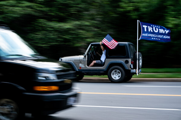 A supporter of President Trump near Trump National Golf Club in Sterling, Va., in July.