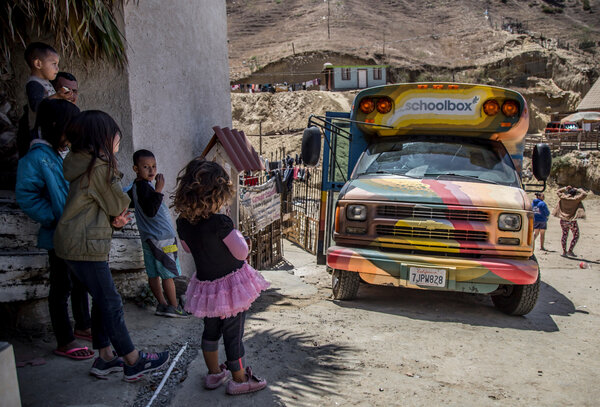 The School Box Project bus parked outside a shelter in 2019. For many months, until the pandemic ceased their operation, the distinctive rainbow mobile-classroom brought volunteer teachers to migrants awaiting immigration court hearings.