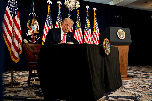 President Trump signed a series of executive actions, including one to bolster unemployment pay, at his golf club in Bedminster, N.J., on Aug. 8.