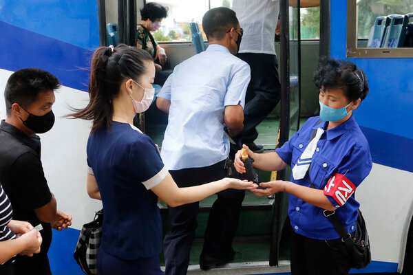 Commuters being disinfected in Pyongyang this month.