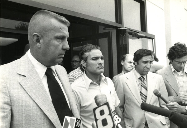 Security: Norman Carlson, left, outside the federal prison in Danbury, Conn., in 1977. He instituted a federal policy of zero-tolerance for the abuse of prisoners by guards.