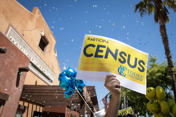 A volunteer holding up a census sign in Perris, Calif., in August.