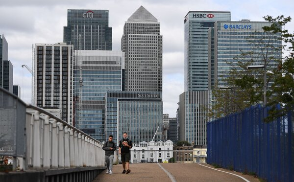 "Offices at Canary Wharf in London on Wednesday. The British government aims to ""showcase the benefits of returning safely to work."""