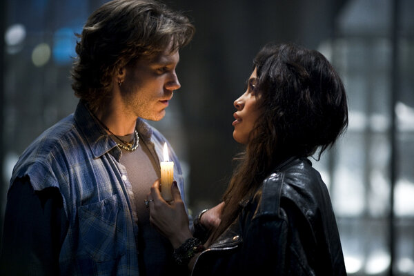 Adam Pascal, left, as Roger, an H.I.V.-positive musician with writer's block, and Rosario Dawson as Mimi, a dancer and his on-and-off girlfriend, in the 2005 movie.