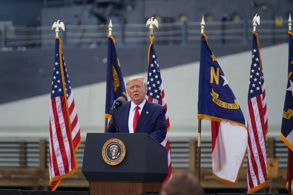 Security: President Trump at the Battleship North Carolina in Wilmington, on Wednesday. He told reporters later that people should test the system by voting twice, an illegal act.