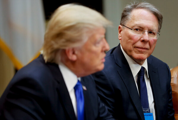 "Wayne LaPierre, chief executive of the N.R.A., with President Trump at the White House. A new book says Mr. LaPierre told the president ""the membership would go wild"" if he moved forward with background check legislation after shootings in 2019."