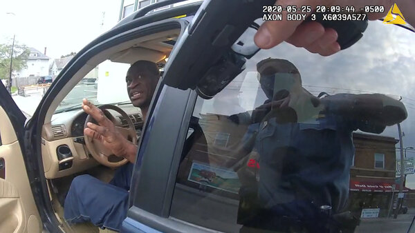 Cars: Video footage from Thomas Lane's body camera shows him pulling his gun and confronting Mr. Floyd as he sat in the car.