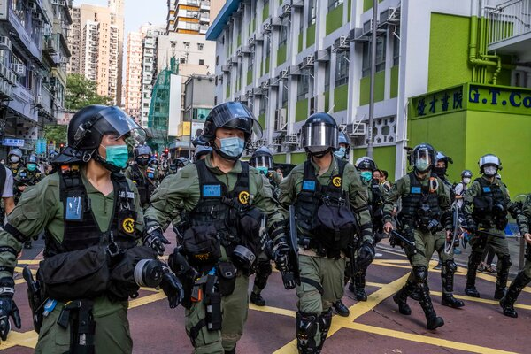 Security: Police officers in riot gear patrolled an area of Hong Kong on Sunday where protesters had called for a rally.