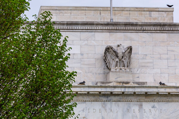 The Federal Reserve could provide hints on Wednesday about how it will reinforce its commitment to leaving interest rates lower for longer.