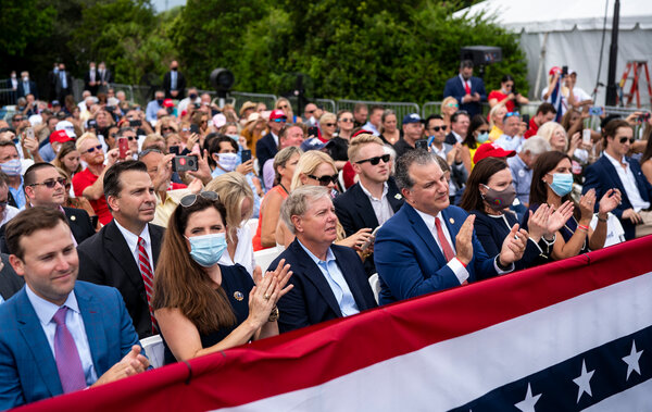 Senator Lindsey Graham and others listened as President Trump delivered remarks in Jupiter, Fla., on Tuesday.