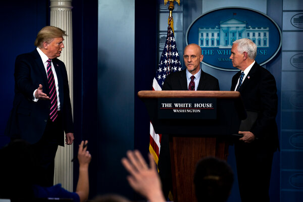President Trump with the Food and Drug Administration commissioner, Dr. Stephen Hahn, center, at the White House in April.