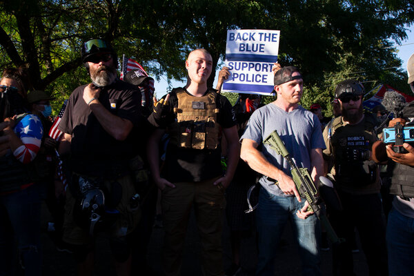 Protesters carrying guns gathered in support of the police and President Trump at city hall in Portland, Ore.  Election Updates: Fires and Coronavirus Shadow Trump on Campaign Trail merlin 176240775 58dcc904 d1ab 4fe6 a7e6 db79be6cd6e8 articleLarge