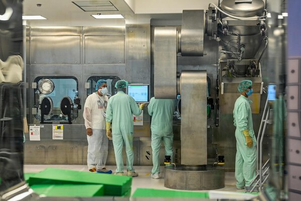 Laboratory technicians supervising tests for the large-scale production of the Oxford vaccine candidate.