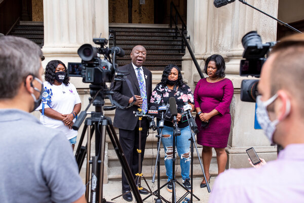 Breonna Taylor's mother, Tamika Palmer, center, during a news conference outside City Hall in Louisville, Ky., in August.
