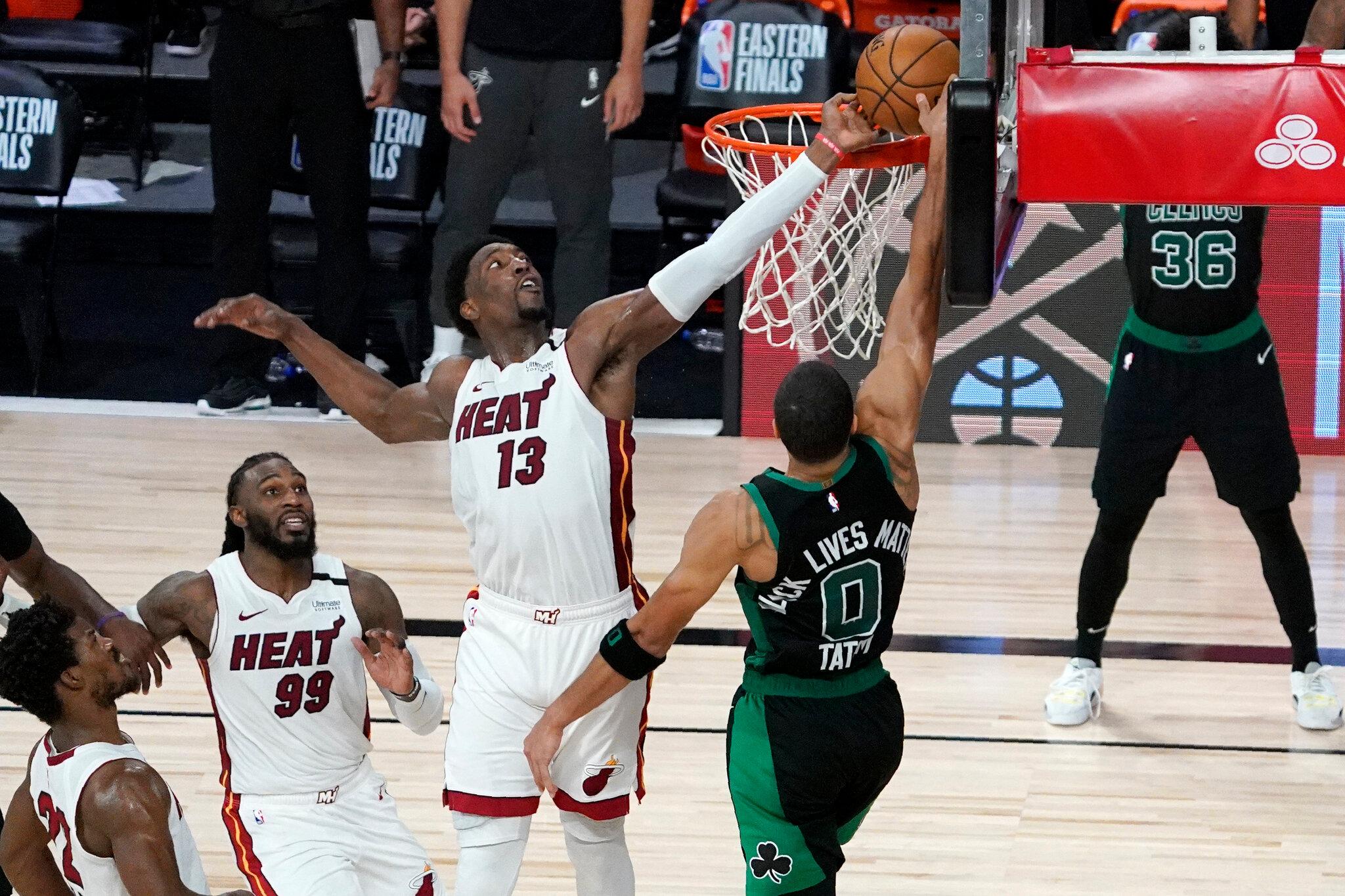 miami heat s bam adebayo blocks a dunk