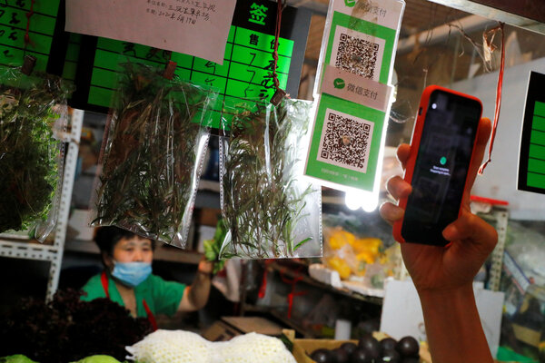 Scanning a QR code using the digital payment services WeChat Pay at a market in Beijing. The Trump administration will bar such payments in the United States at midnight on Sunday.
