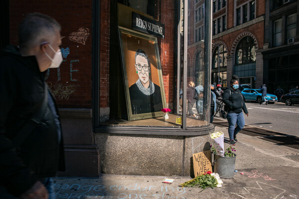 A portrait of Supreme Court Justice Ruth Bader Ginsburg is displayed in a storefront in Manhattan.