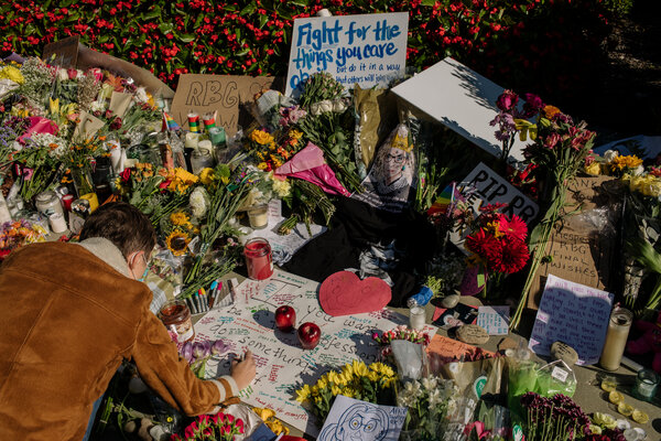People visited a memorial set up outside the Supreme Court on Saturday. The death on Friday of Justice Ruth Bader Ginsburg immediately led to questions about how Republican senators would proceed.