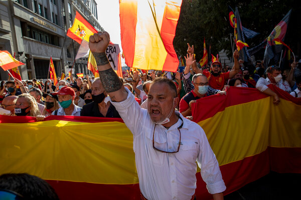 Protesters shouted slogans during a protest in the streets of Madrid on Sunday.