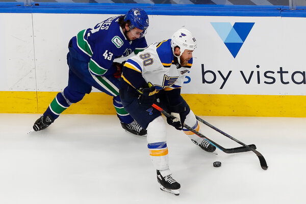 The Canucks' Quinn Hughes, left, also had a standout postseason, setting a playoff record for points by a rookie defenseman until Colorado's Cale Makar broke it the next day.