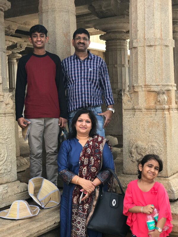 "Amit Jain with his family last year. Mr. Jain, the global head of I.T. infrastructure for Tata Consultancy Services, died in March after a heart attack. ""He was overworked and extremely exhausted,"" said his brother, Mukul Jain."