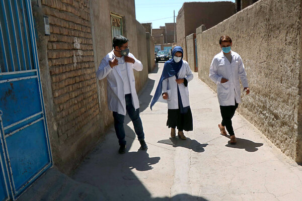 A medical team goes door-to-door to conduct Covid-19 tests in Herat, Afghanistan in May.