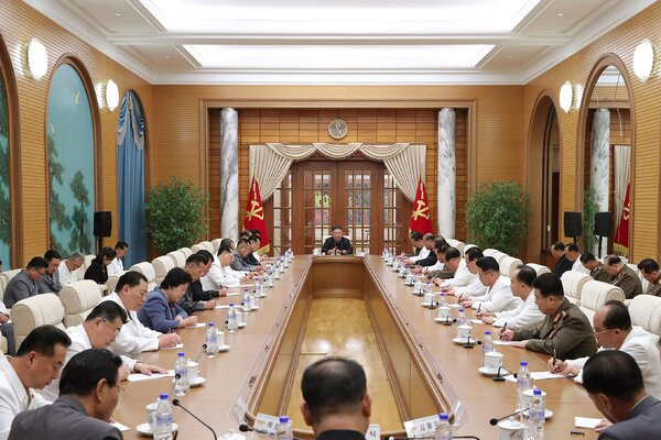 North Korea's leader, Kim Jong-un, center, attended a government meeting in Pyongyang on Tuesday.