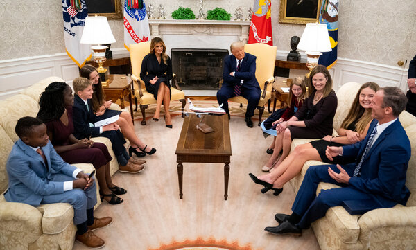 President Trump and Melania Trump spoke with Judge Amy Coney Barrett and her family before her Supreme Court nomination ceremony at the White House on Sept. 26.