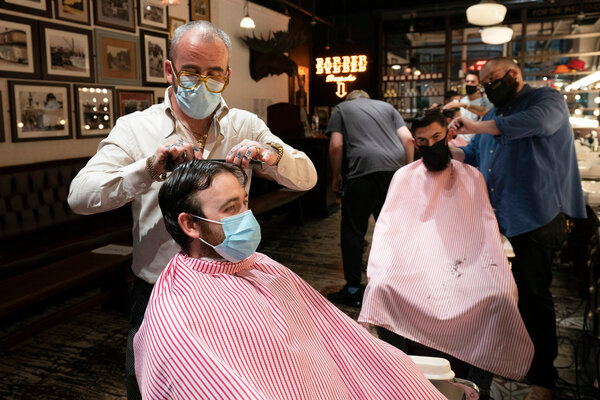 A barbershop in Manchester, England, in July. British lawmakers on Monday reported a technical problem that left 16,000 virus cases in the country uncounted.