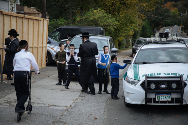 Police officers in Palm Tree, N.Y., handing out face masks to residents this week.