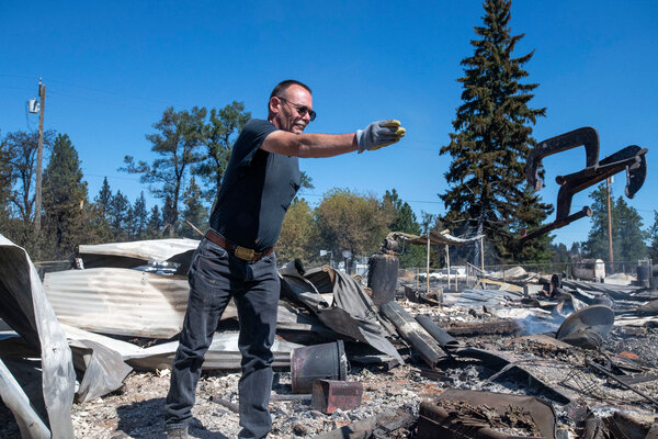 Jim Murray, 59, examined the ruins of his house in Malden, Wash., on Tuesday, one day after a wildfire swept through.