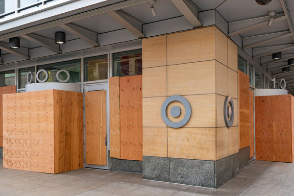 Target's boarded-up headquarters in Minneapolis last month. The company said last week that employees there would continue to work at home through June 2021.