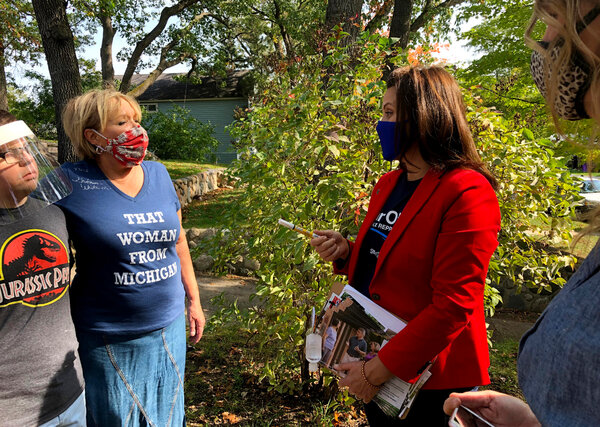 Gov. Gretchen Whitmer of Michigan, center right, during a campaign visit to Traverse City, Mich., on Friday, a day after police announced a foiled plot to kidnap the governor.