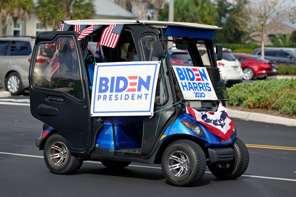 A golf cart parade for the Biden campaign in The Villages, Fla.