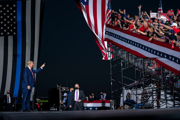 President Donald Trump acknowledging supporters at a campaign rally Friday in Macon, Ga.