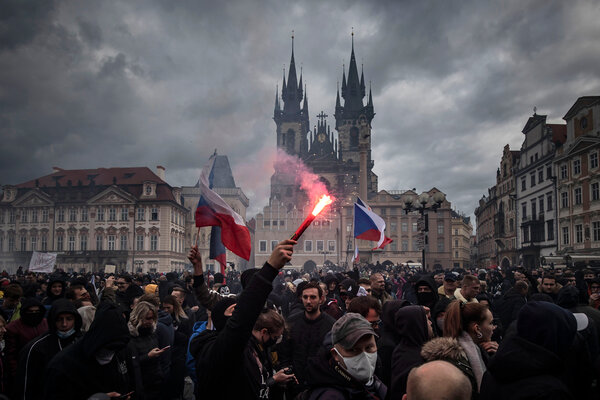 Protesting in the historic center of Prague on Sunday.