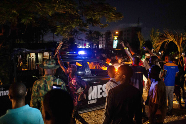 A Nigerian state security vehicle moved through a crowd of protesters in the Lagos area on Tuesday.