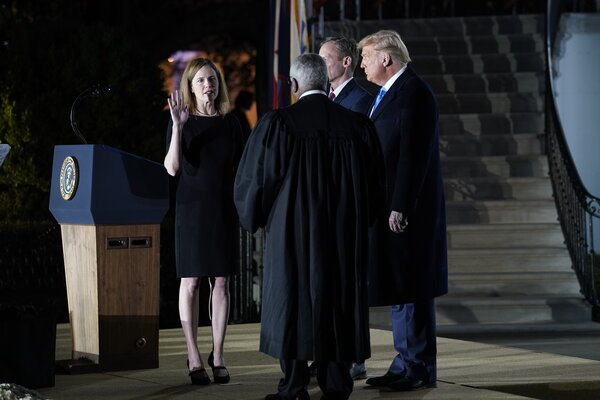 Justice Clarence Thomas swore in Justice Barrett during a ceremony on the White House lawn.