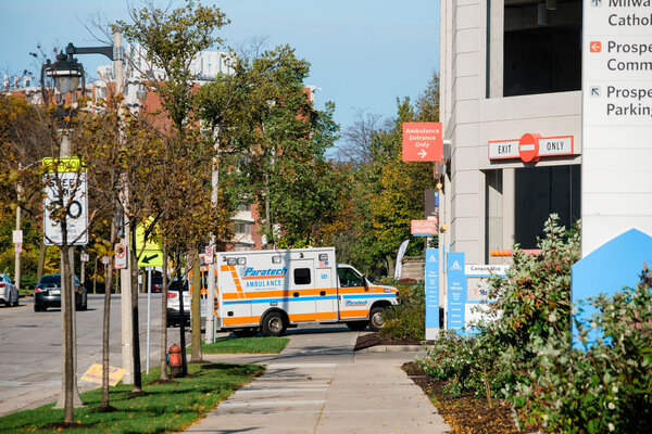 An ambulance arriving at a hospital in Milwaukee last week. Wisconsin has opened an emergency field hospital to treat a growing number of coronavirus patients.