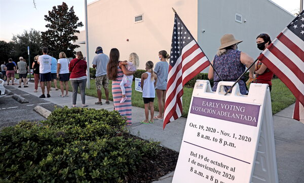 People lined up to cast their ballots on Sunday morning in Celebration, Fla.