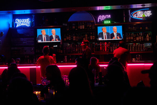 People watching the first debate between President Trump and Joseph R. Biden Jr. at a restaurant in Las Vegas.