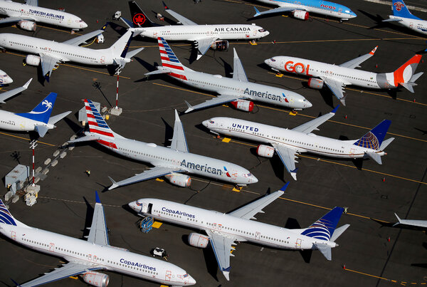 Grounded Boeing 737 Max airliners at Boeing Field in Seattle in July.Boeing is dealing with crises caused by the grounding and the pandemic.