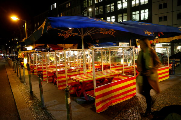 Empty tables at a restaurant in Berlin. The outlook for the eurozone has darkened as Germany and France imposed harsh new restrictions to combat the pandemic.