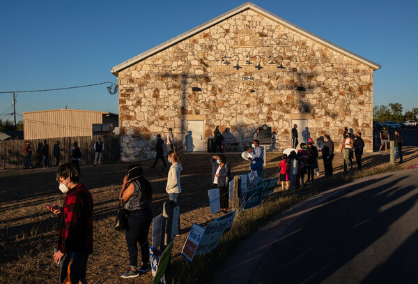 Voters waiting to cast their ballots in Pflugerville, Texas, on Friday.